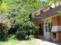 Квартира с садом рядом с Игало