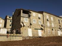 Апартаменты в доме у моря в Петроваце